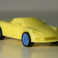 Porsche carrera GT printed in PLA yellow, blue and soft-PLA black with 0.15mm layer thickness
